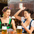 friends drinking beer in bavarian pub playing cards stock photo © kzenon