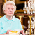 senior woman with coffee and cake in cafe stock photo © kzenon