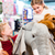 two kids with stuffed elephant in toy store playing stock photo © kzenon