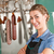 smiling female butcher at butchery stock photo © kzenon