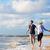 пару · работает · волны · пляж · женщину · весело - Сток-фото © kzenon