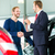 young man and seller with auto in car dealership stock photo © kzenon