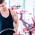 man taking weights from stand in fitness gym stock photo © kzenon