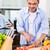 asian man cutting salad in kitchen stock photo © kzenon