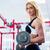 fitness · gimnasio · mujer · entrenamiento · de · la · fuerza · pesos - foto stock © kzenon