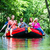 friends paddling on rubber boat at forest river or creek stock photo © kzenon