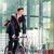 alegre · jovem · empregado · equitação · utilidade · bicicleta - foto stock © kzenon