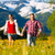couple running in the meadow with mountain stock photo © kzenon