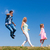 mom and daughter walk in single file on is jumping stock photo © kzenon