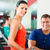woman and Personal Trainer in gym, with dumbbells stock photo © Kzenon