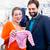couple expecting baby buying children wear stock photo © kzenon