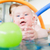 baby in paddle pond reaching for toy ball in water stock photo © kzenon