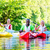 friends paddling with canoe on forest river stock photo © kzenon