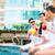 asian friends sitting by hotel swimming pool stock photo © kzenon