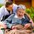 enfermeira · empurrando · senior · mulher · cadeira · de · rodas · andar - foto stock © kzenon