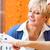 vrouw · gehoorapparaat · oor · gezondheid · huid - stockfoto © kzenon