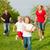 család · futball · zöld · sugarak · anya · ugrás - stock fotó © kzenon