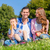 family having picnic sitting in grass on meadow stock photo © kzenon