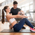 personal trainer timing young fit woman during isometric exercis stock photo © kzenon