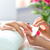 woman in nail salon receiving manicure stock photo © kzenon