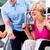 senior woman exercising with personal trainer in gym stock photo © kzenon