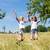 happy children in a meadow jumping stock photo © kzenon