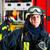jonge · brandweerman · uniform · permanente · klaar - stockfoto © kzenon