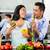 asian couple cooking food together in kitchen stock photo © kzenon