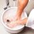 man having hydrotherapy water footbath stock photo © kzenon