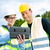 builders with blueprint on construction site stock photo © kzenon
