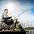 Man fishing at lake sitting on jetty stock photo © Kzenon