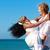 счастливым · пару · пляж · черную · женщину · кавказский · человека - Сток-фото © Kzenon