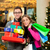 couple with christmas presents and bags in shopping mall stock photo © kzenon