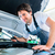 auto mechanic working in car service workshop stock photo © kzenon