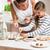 terhes · anyu · kicsi · lánygyermek · sütés · együtt - stock fotó © kzenon