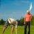 jonge · paar · spelen · golfbaan · golf · bal - stockfoto © Kzenon