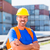 worker and row of containers on port stock photo © kzenon