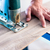 DIY worker cutting wooden panel with jig saw stock photo © Kzenon