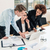 three members of a young professional team working together stock photo © kzenon