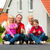 family sitting in front of home stock photo © kzenon