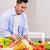 asian man cutting vegetables and salad stock photo © kzenon