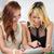 two stylish young women surfing the net stock photo © kzenon