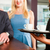 Working colleagues - a man and a woman - sitting in cafe stock photo © Kzenon