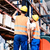 worker team taking inventory in logistics warehouse stock photo © kzenon