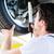 mechanic working in car workshop on wheel stock photo © kzenon