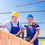 construction site workers building house with crane stock photo © kzenon