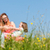 Family holding hands in summer in the grass stock photo © Kzenon