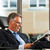 Boss in his office reading newspaper stock photo © Kzenon