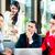 asian businesspeople having meeting stock photo © kzenon