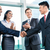 business handshake in lofty office with city view stock photo © kzenon